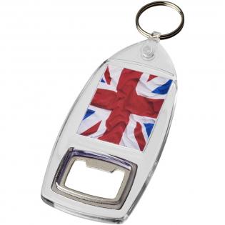 Porte-clés transparent R6 avec décapsuleur et anneau fendu en métalainsi que clip en plastique dynamique. La fixation de l'attache en plastique présente un profil plat idéal pour les envois. Dimensions de l'insert pour impression: 4,0cm x 3,2cm.