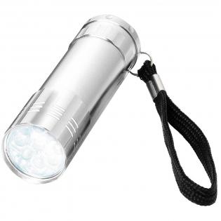 Lampe stylée avec 9 LED blanches puissantes, une lanière pour le poignet et un bouton marche/arrêt à l'arrière. Fonctionne avec 3 piles AAA (non fournies).