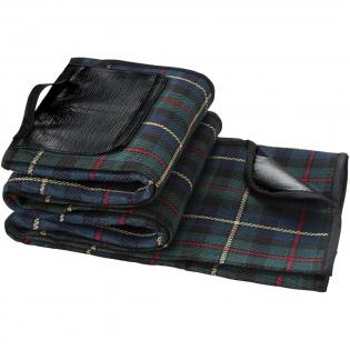 Klassische Decke mit Tartanmuster. Die Unterlage schützt vor Wasser und Schmutz. Der Griff macht es einfach, diese Decke zu transportieren. Größe 145 x 130 cm.