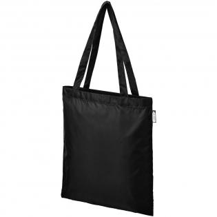Langlebige Tasche aus 100% recyceltem Kunststoff, der zur Reduzierung von Kunststoffabfällen beiträgt. Ausgestattet mit zwei Griffen mit einer Höhe von 27 cm. Tragekraft bis zu 10 kg Gewicht.
