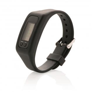Bracelet en silicone ajustable et podomètre en ABS qui compte les pas, les calories brulées et la distance parcourue. Les piles sont incluses et ont une durée de vie d'environ un an.