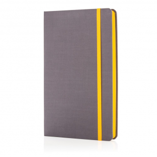 Fashionable fabric ruled A5 notebook with coloured sides. 240 pages of 80g/m2 inside. Cream coloured pages. The sides of the pages are matching with the elastic band.