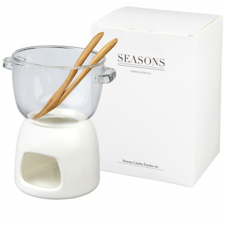 A chocolate fondue set for two. The set includes a 340 ml glass bowl, a porcelain warmer, and two bamboo forks. Presented in a Seasons gift box.