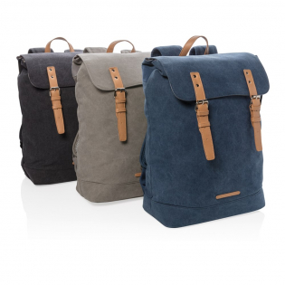"""Carry your essentials for casual travel in this durable canvas backpack. This model features a padded section for your laptop up to 15.6"""". The top flap closes with two imitation leather magnetic buckles. PVC free."""