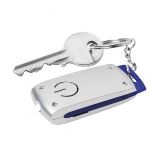 Porte-clés avec lampe de poche pourvu d'une lampe LED à forte lumière blanche. Avec accent coloré. Incl. piles bouton.