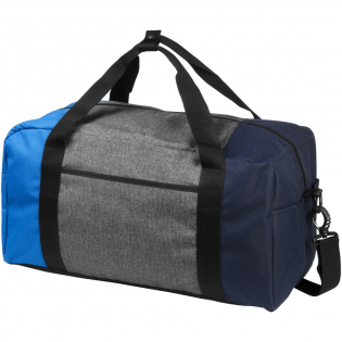 """The Three-way colourblock 19"""" duffel is an on-trend duffel designed to carry all your essentials. There's plenty of room for all of your belongings with the main zippered compartment, the graphite front slash pocket and the side hook and loop pocket. The button closure grab handle and adjustable, removable shoulder strap help you carry this duffel with ease. 600D PolyCanvas."""
