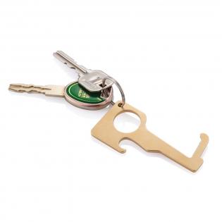 Porte-clés en laiton (62% en cuivre et 38% en zinc) qui vous permet d'utiliser, d'une manière hygiénique et sans contact, les surfaces partagés tels que les poignées de porte, les boutons d'ascenseur ou encore les distributeurs. Le laiton présente des propriétés de surface antimicrobiennes uniques, de sorte que 99 % des bactéries ne survivront pas sur ce métal. Prenez le porte-clés où que vous soyez pour éviter de toucher les surfaces publiques quand ce n'est pas nécessaire.