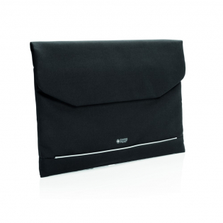Carry your laptop in style and protected with this luxury Swiss Peak padded laptop sleeve incorporating magnetic closing flap. Inside it has one front zippered compartment with an RFID protected pocket. Front cover with reflective safety strip. PVC free.