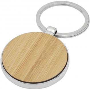 Runder Schlüsselanhänger in Premiumqualität aus Bambus mit Metallgehäuse aus Zink Legierung, geliefert in einem braunen Papierumschlag. Der Durchmesser des Schlüsselanhängers beträgt 4 cm. Hergestellt für Lasergravur.